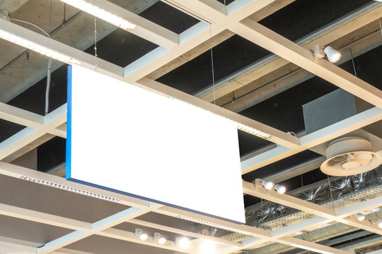 Mock up. Horizontal rectangular white empty signage, information board inside in shopping mall, store