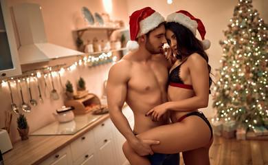 Sexy couple on kitchen