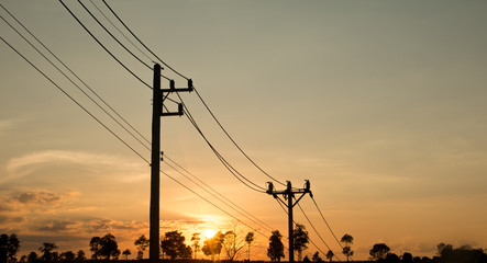 an old Power pole with line on Silhouette environment, High level of noise. sun rise or sun set time