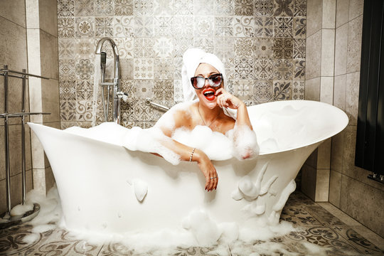 Woman in bath and towel on head.