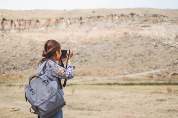 Back view Asian woman using camera  taking photo for landscape view photography