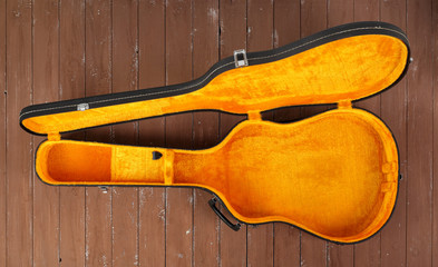 Musical instrument - Open black and yellow acoustic guitar hard case