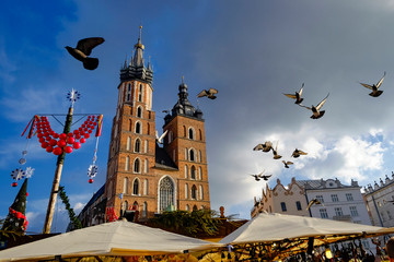 Autocollant pour porte Cracovie View on famous st. Mary`s basilica with pigeon flying during the sunny day in Krakow, Poland. 11-12-2015
