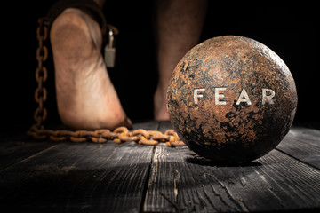 Fear is ball on the leg. Concept of fear.