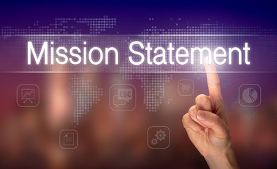 A hand selecting a Mission Statement business concept on a clear screen with a colorful blurred background.