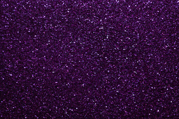 Dark purple sparkling background from small sequins, closeup. Brilliant backdrop.