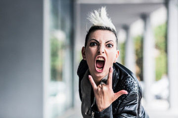 Portrait of screaming punk woman at an arcade