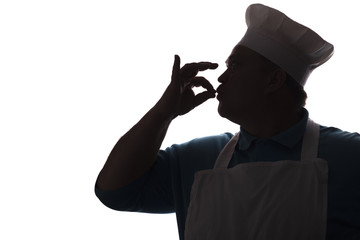 silhouette of a happy chef on a white isolated background, profile of a male face in a cook hat,food industry concept