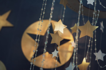 Gold star in sun light with stars background