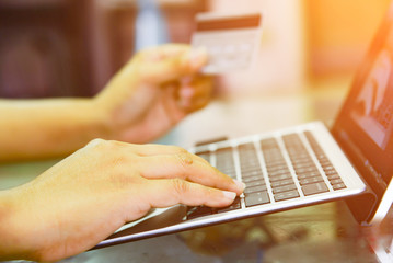 Hands holding credit card and using laptop, Online shopping