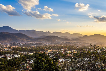 Landscape view over the city in the sunset lights from Mount Phousi, Laos