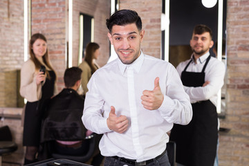 Satisfied male client of barbershop