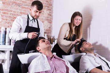 Two men enjoying hairwash by hairdressers