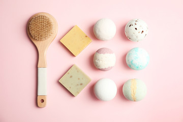 Wall Mural - Flat lay composition with bath bombs, brush and soap bars on color background