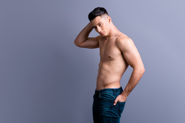 Photo of half turn brunet man in casual denim jeans pose isolate