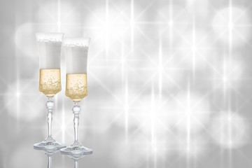 Glasses of champagne on festive background.