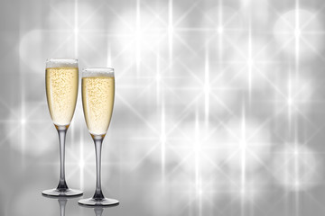 Two glasses of champagne on festive beautiful background.