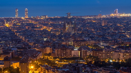 Foto auf Acrylglas Barcelona Panorama of Barcelona night to day timelapse, Spain, viewed from the Bunkers of Carmel
