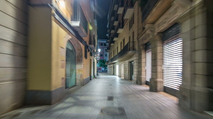 Fast walk through narrow street in the Old Town timelapse hyperlapse, Barcelona. Gothic district illuminated at night