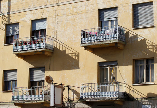 Rusted TV satellite dish is seen on an apartment balcony in Asmara