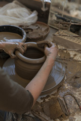 Shaping clay on a pottery wheel