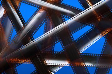Analog film strip. Tangled movie plot.