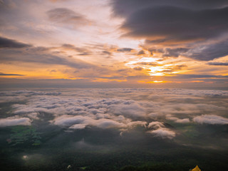 Beautiful Sunrise Sky with Sea of the mist of fog in the morning on Khao Luang mountain in Ramkhamhaeng National Park,Sukhothai province Thailand
