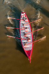 Crew in action on a rowing boat during a competition