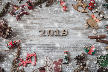 Christmas flat lay styled scene - top view frame with christmas decorations on a white background, Idea of merry new year 2019 holiday. Top view
