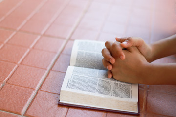 Hands is on the bible.