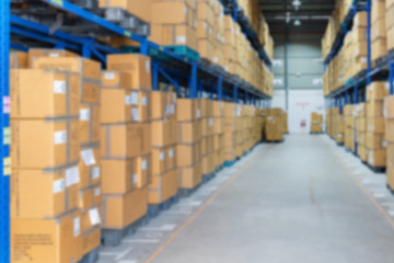 blur image of cargos in a warehouse