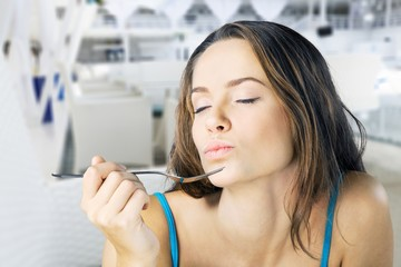 Young woman eating delicious food with fork