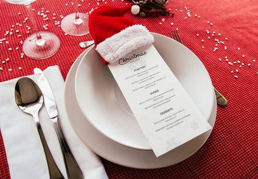 Menu on Christmas Themed Table Mockup