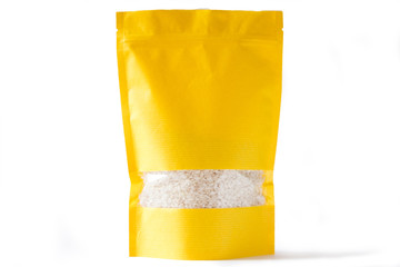yellow paper doypack stand up bio pouch with window  zipper on white background filled with rice
