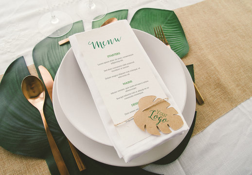 Menu on Dinner Table with Tropical Leaf Mockup