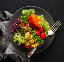 Photo sur Plexiglas Plat cuisine Buddha bowl, healthy and nutritious salad with a variety of vegetables, nuts and tofu cheese,delicious and nutritious vegan meal, top view