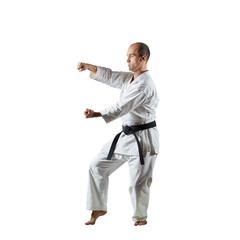 Athlete doing formal exercises on an isolated white background.