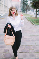 Business Women Style. Woman Going To Work Walking Downstairs. Portrait Of Beautiful Smiling Female In Stylish Office Clothes Going Old Town.