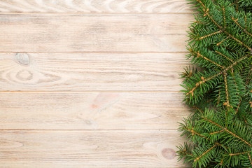 Christmas gray wooden background with fir tree and copy space. top view empty space for your design