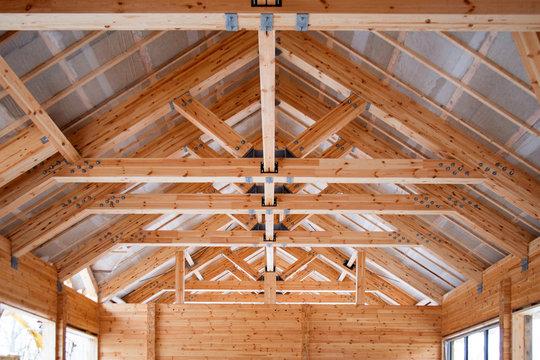 roof construction of big wooden trusses closeup