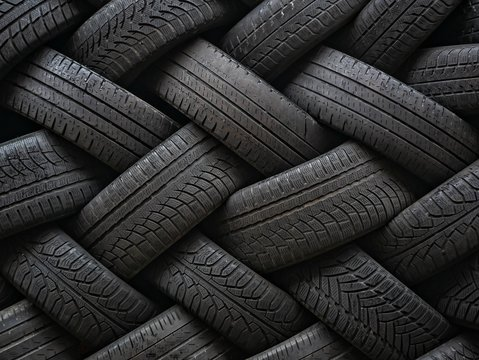 Used auto tires stacked in piles.