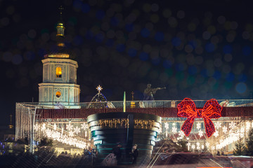 Christmas tree decorated with lights and Sophia Cathedral on background. Kiev, Ukraine