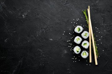 Vegetarian sushi roll with cucumber. Japanese cuisine. Top view.