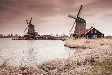 Wooden windmills on Zaan river coast
