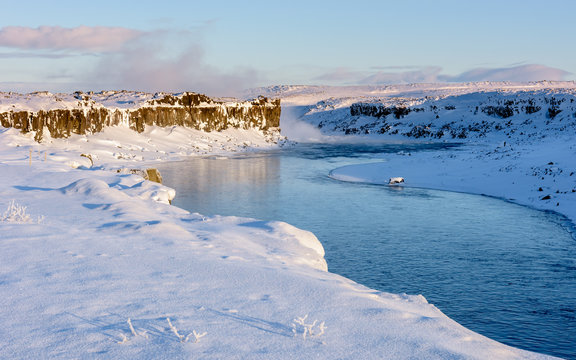 Jokulsa a Fjollum river near Dettifoss water at dawn on cold, snowy winters morning