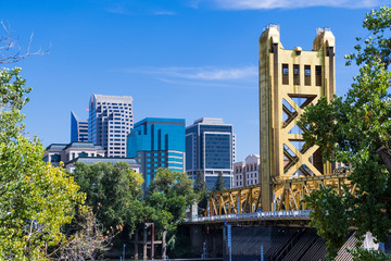 View towards the Tower Bridge and the skyscrapers in downtown Sacramento on a sunny day; California Wall mural