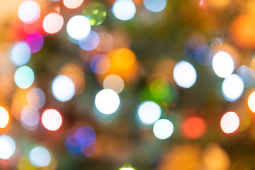 Background of blurred colorful, multicolored, multi-colored, Christmas ornament bokeh round circles of green, red, orange, blue colors