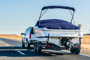 Truck towing a  boat on the interstate, California