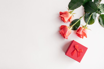Fresh red roses and red bow gift box on white background. Valentines Day, love, romance mock up, background