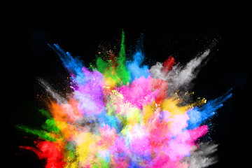 abstract colored dust explosion on a black background.abstract powder splatted background,Freeze motion of color powder exploding/throwing color powder, multicolored glitter texture. Wall mural